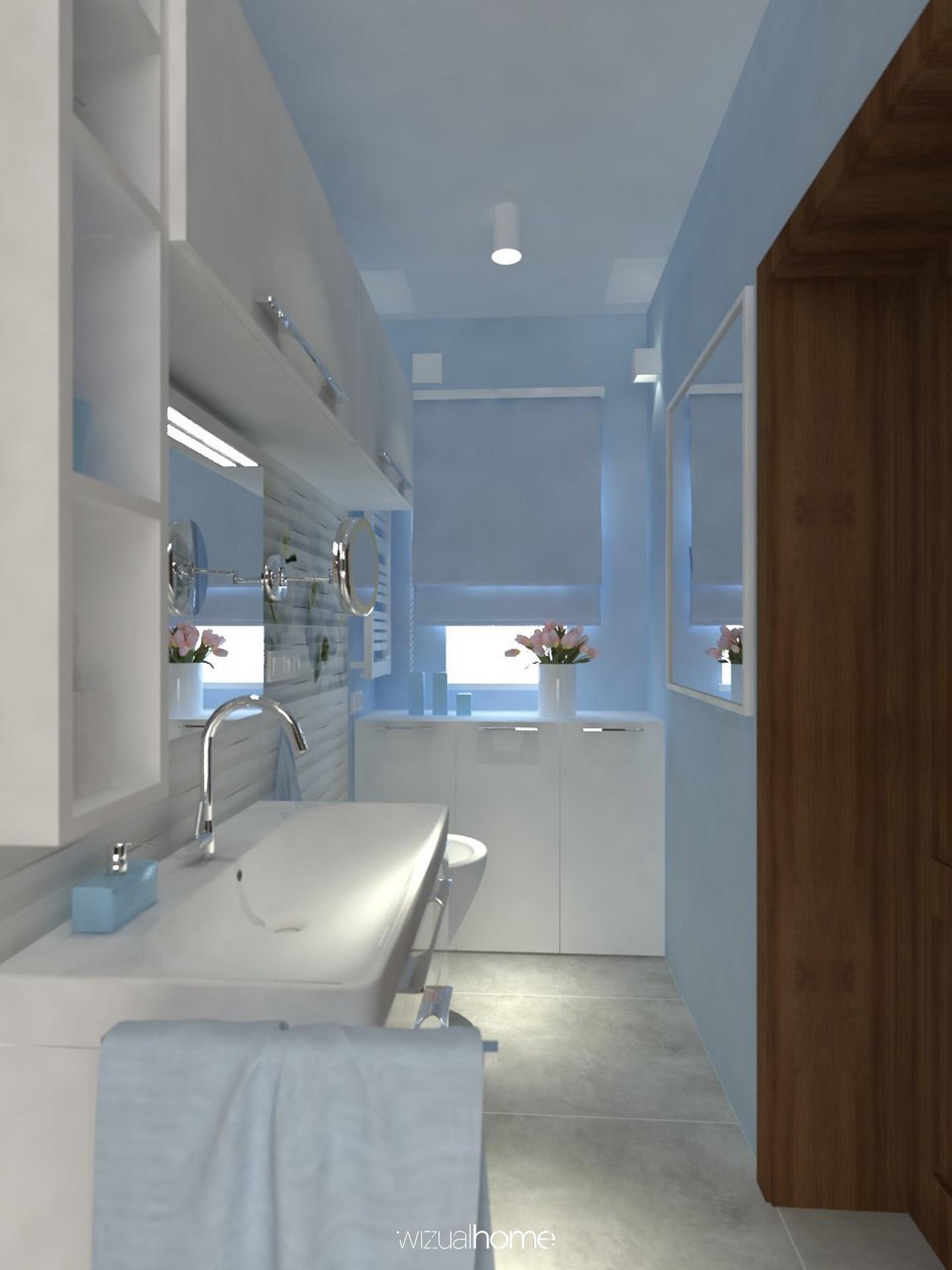 Projekt łazienki w kolorze niebieskim w domku jednorodzinnym.