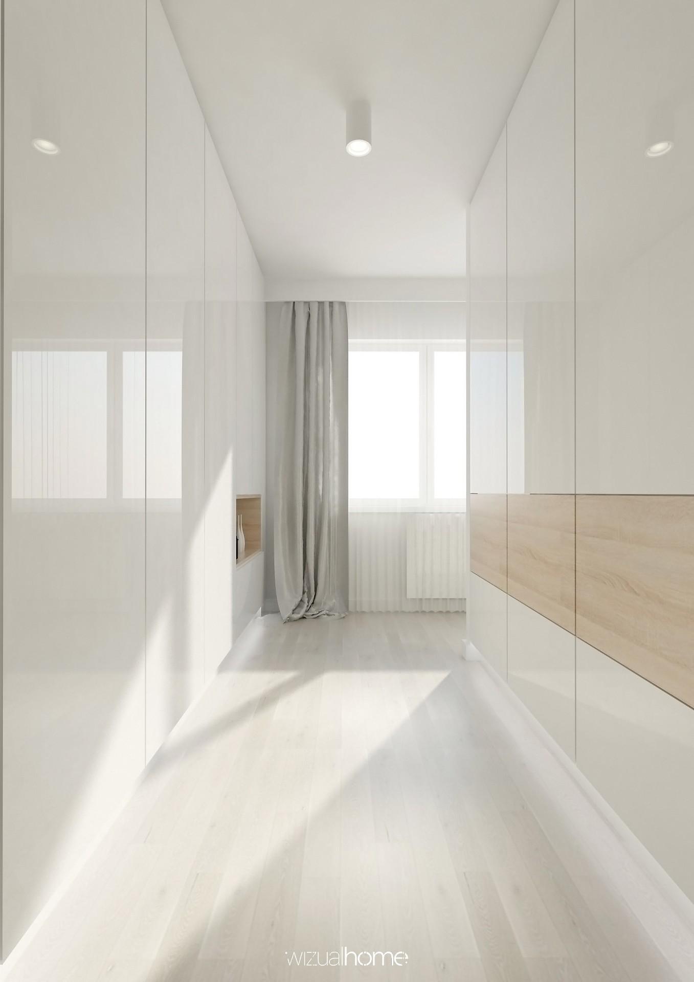 Projekt garderoby w odcieniach bieli i jasnego drewna